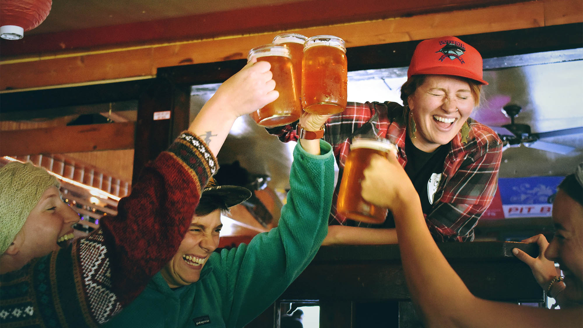 People Cheersing in Bar