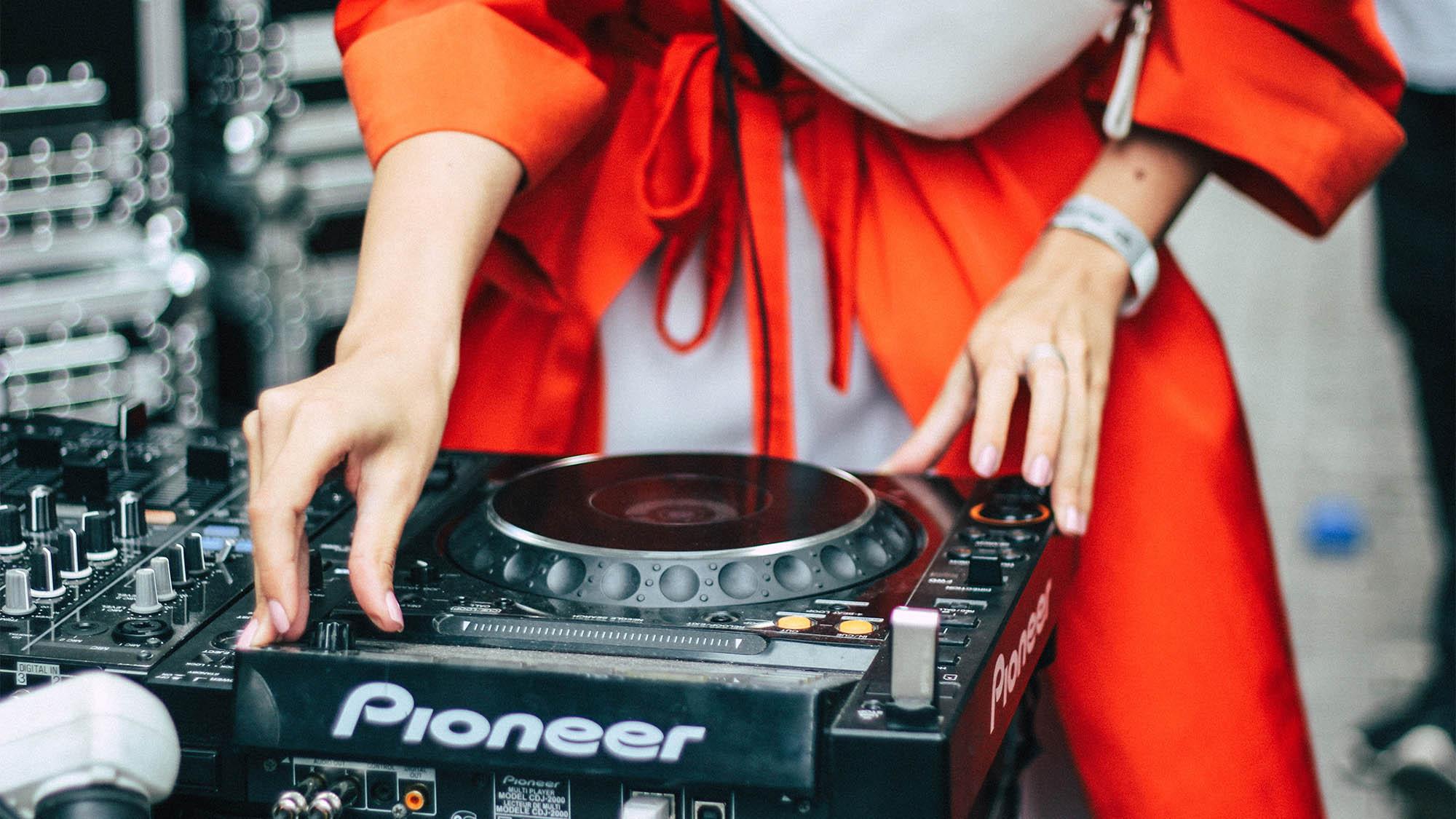 Womens Hands DJing