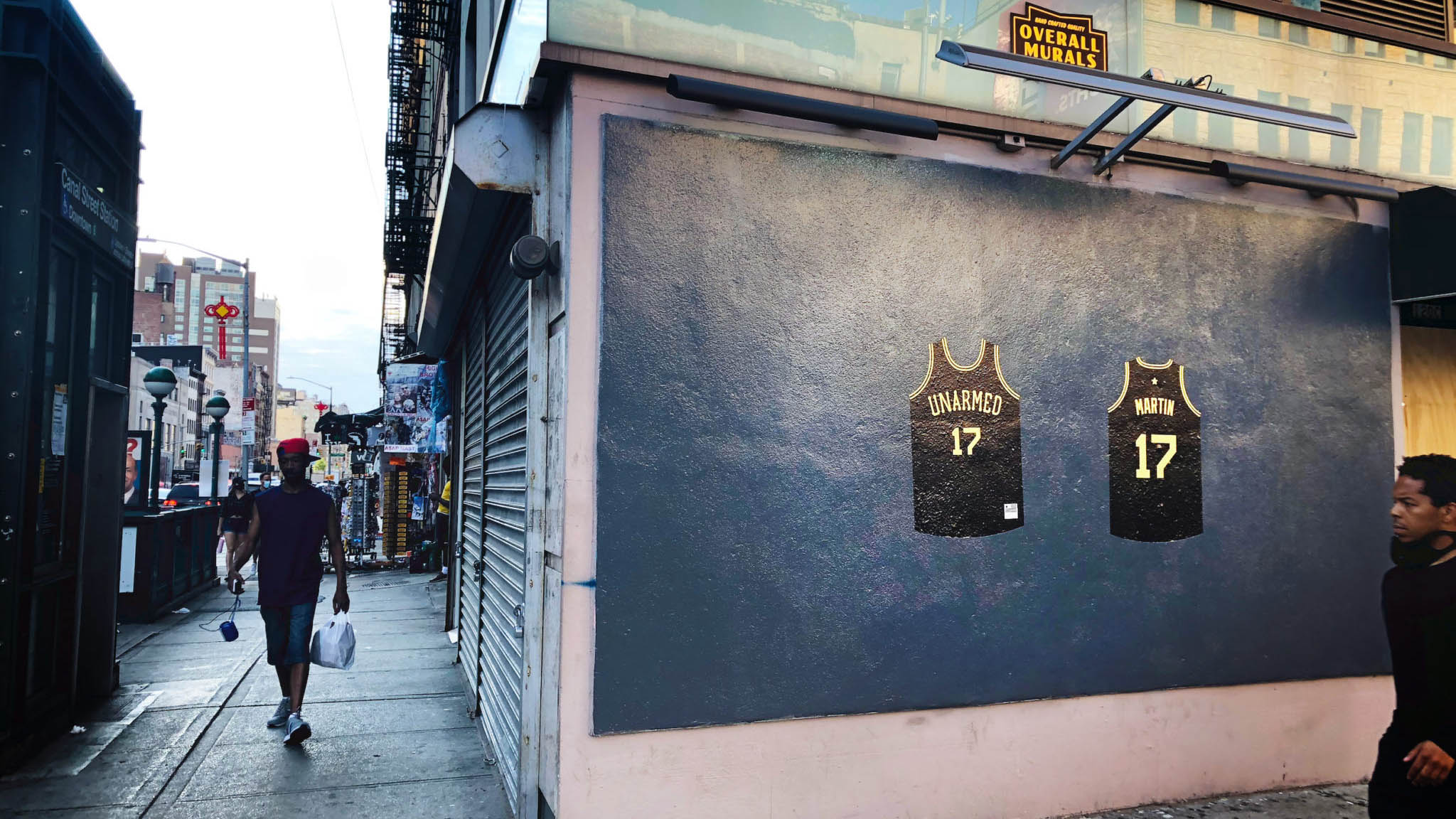 Two Black Jerseys Hanging on Wall Art Exhibit