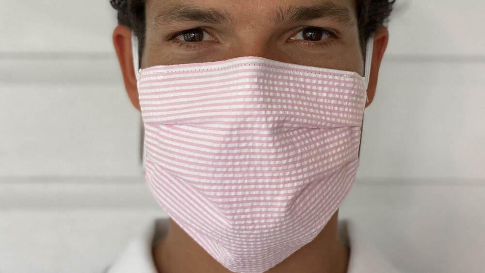 Man Wearing Pink White Seersucker Face Mask