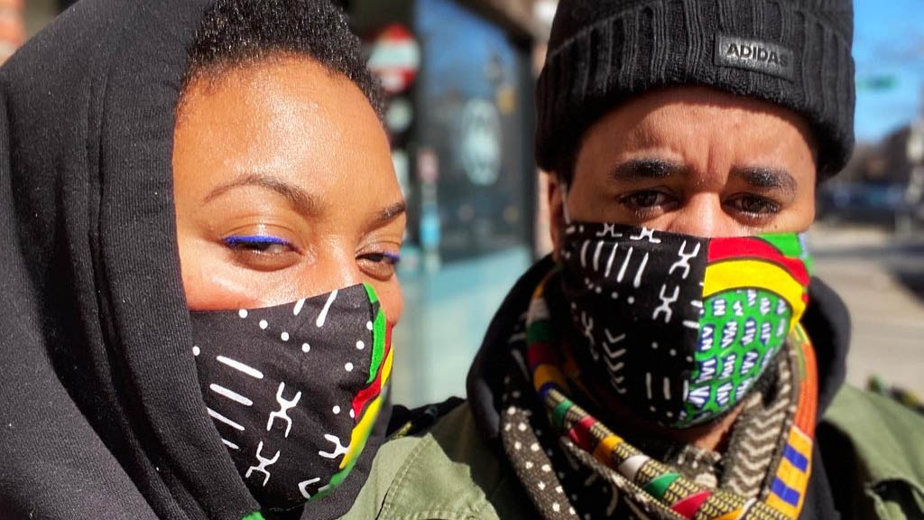 Woman and Man Wearing African Print Face Masks