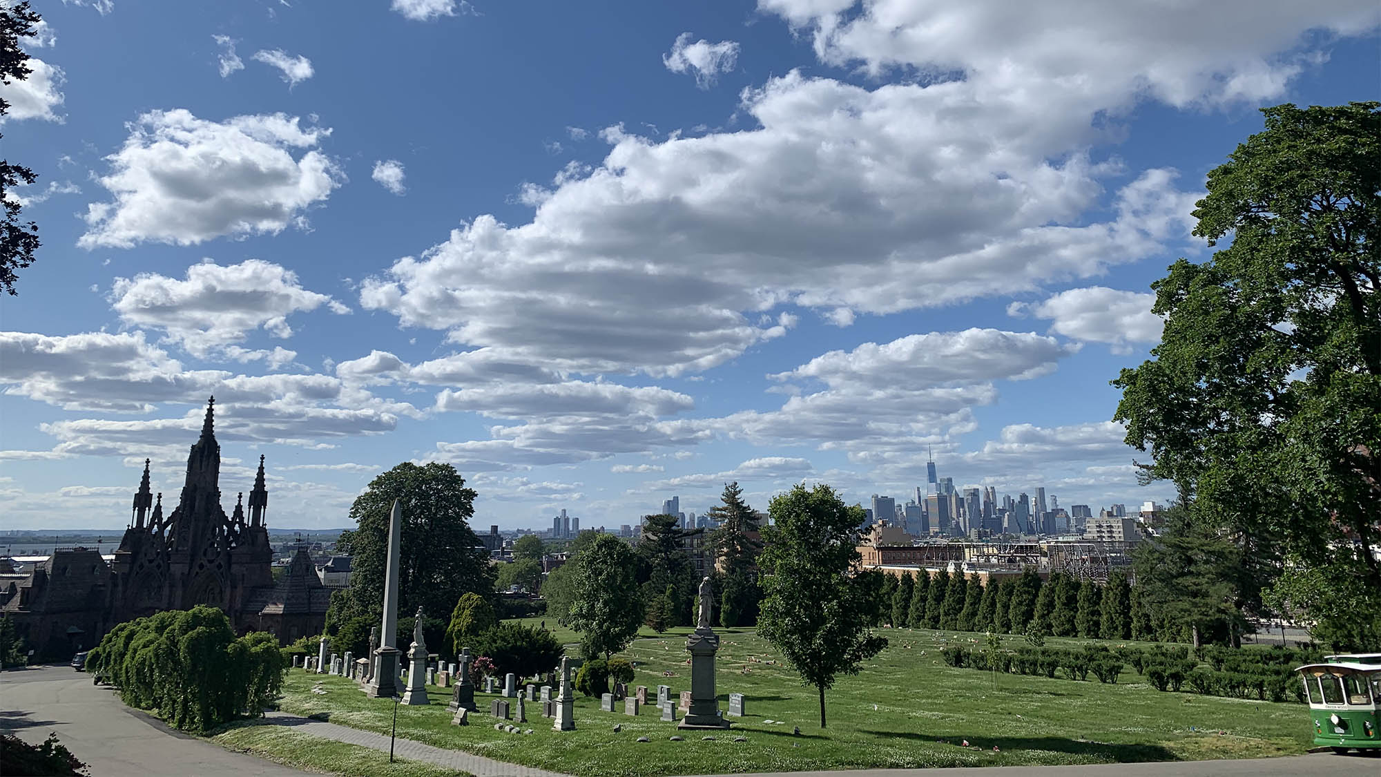 Headstones at Greenwood Cemetery Brooklyn with Manhattan skyline in background
