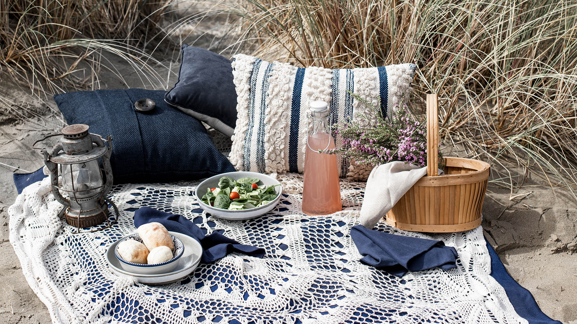 Picnic Food and Drink on Blanket at Beach