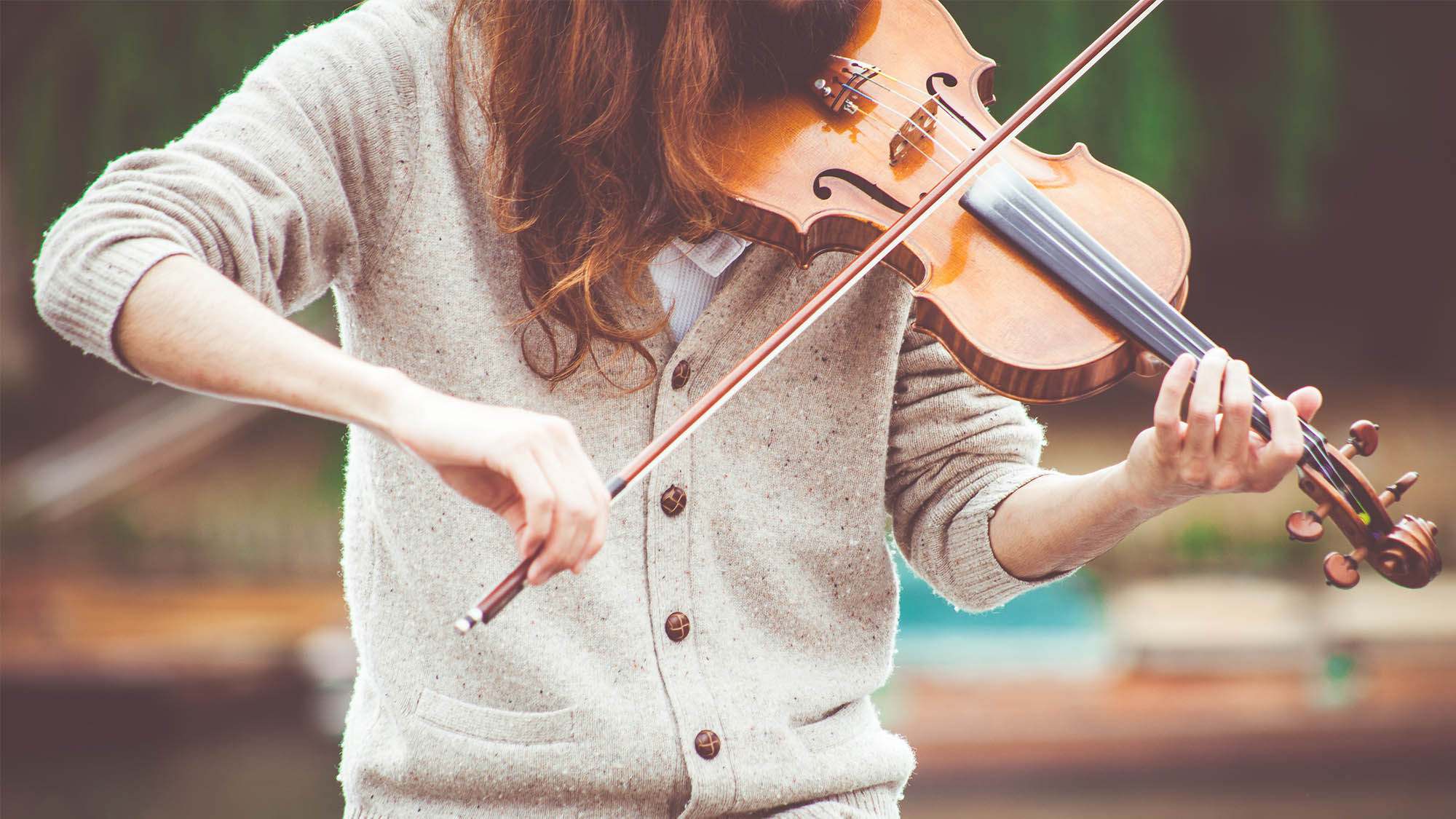 Closeup Neck Down Woman's Arms Playing Violin