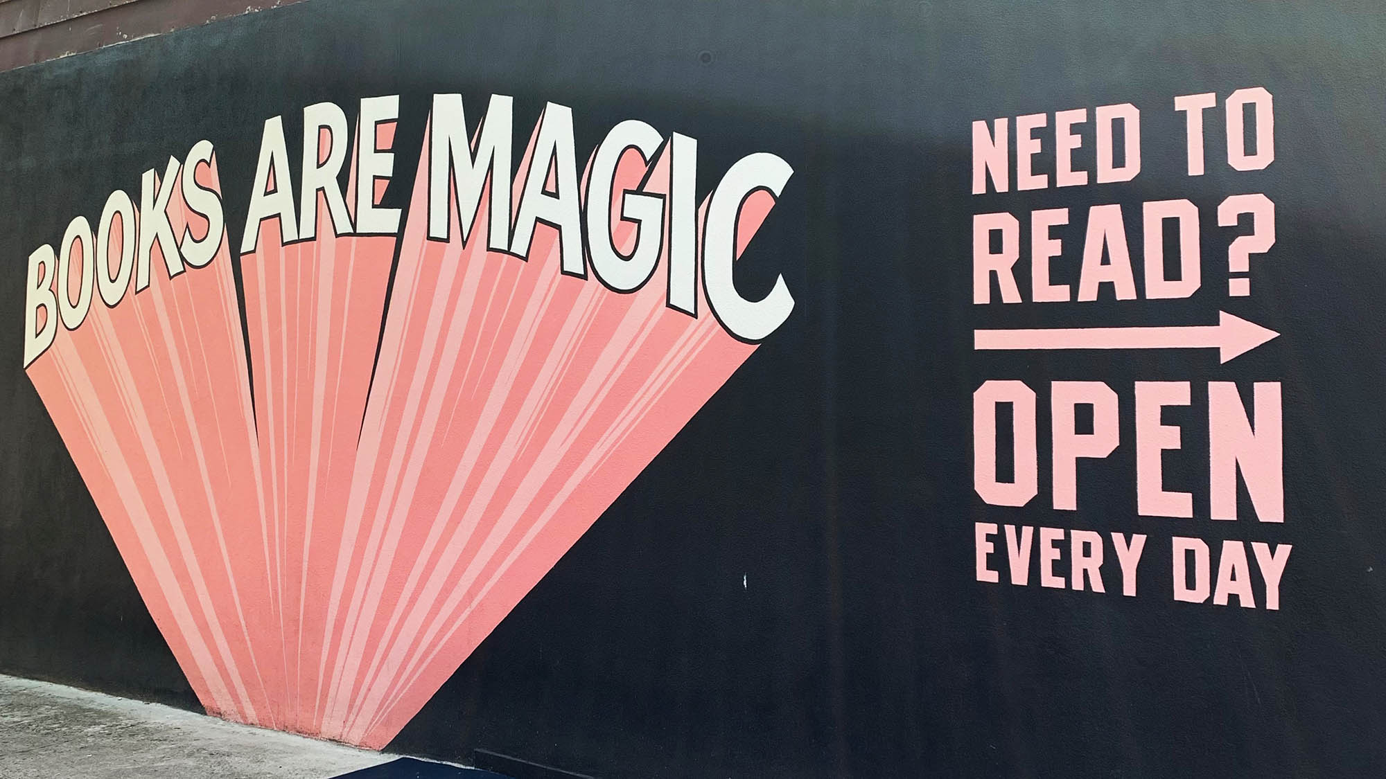 Books Are Magic mural on outside wall of Brooklyn bookstore