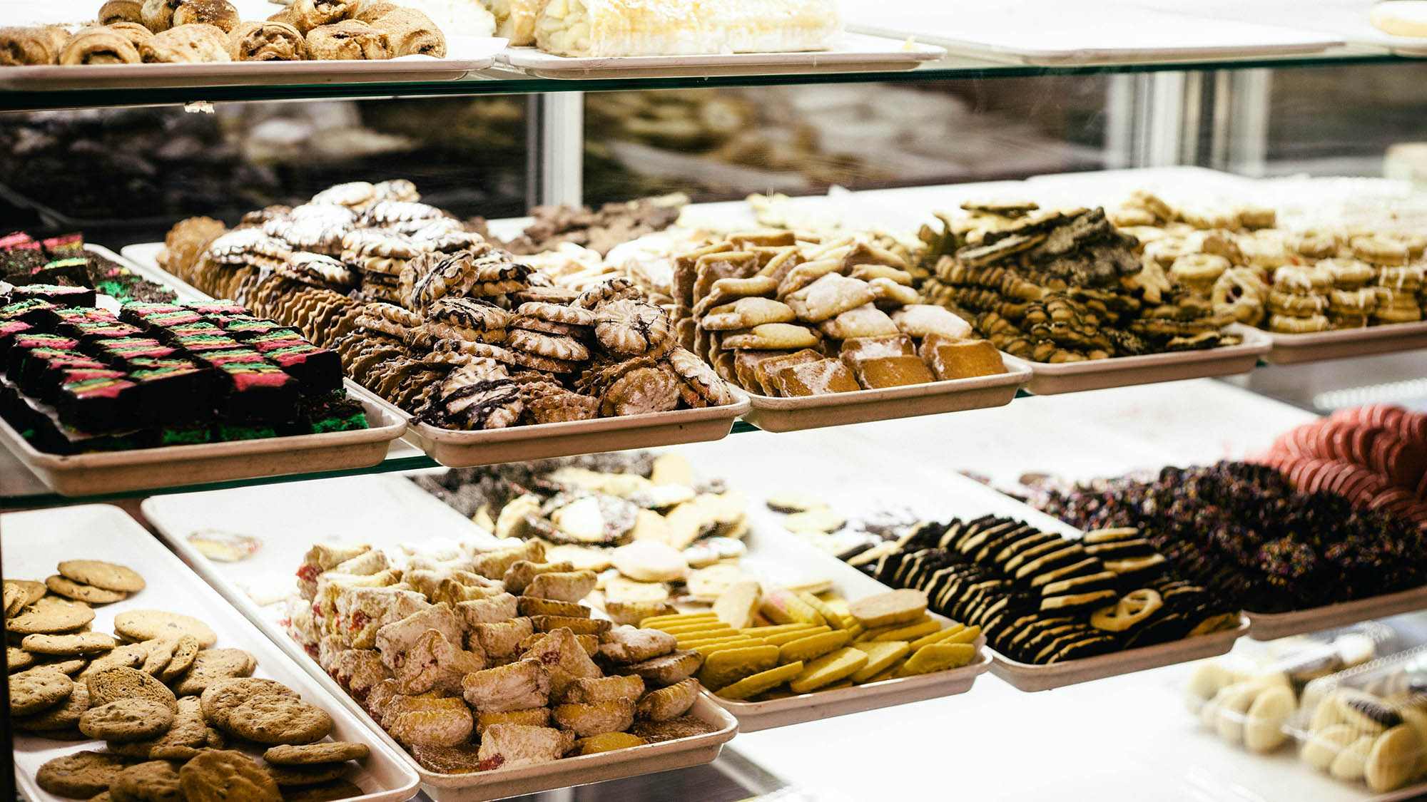 Assorted bakery cookies on shelves