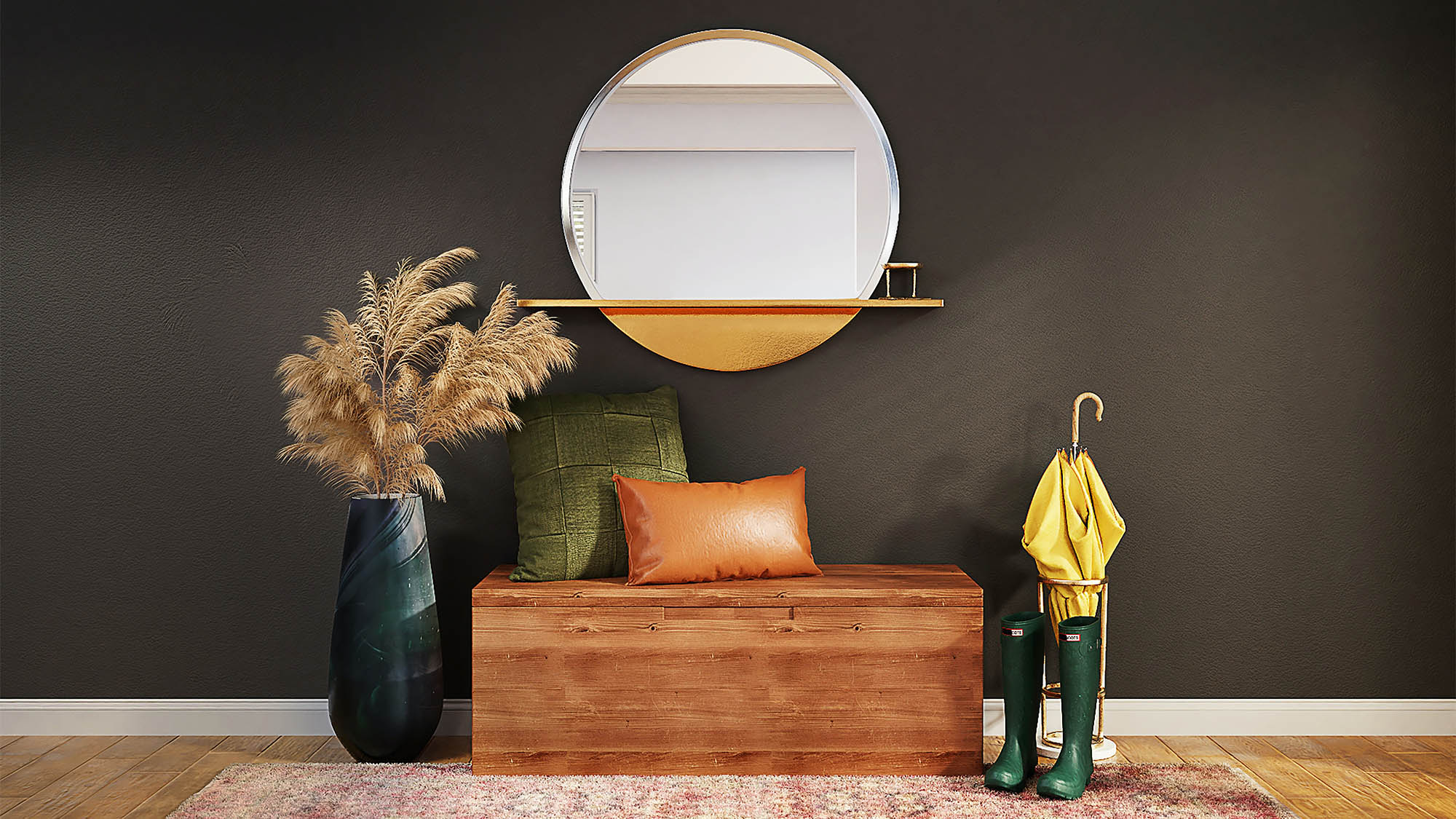 Foyer with dark gray wall and large center round mirror above a wooden chese with orange and green pillow flanked by green hunter boots with yellow umbrella and green planter